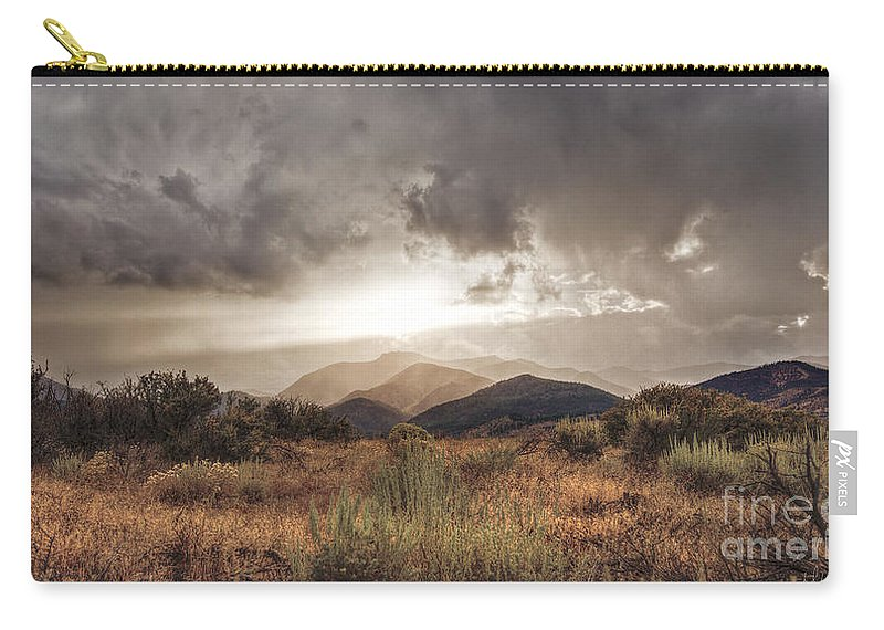 Clouds Carry-all Pouch featuring the photograph Storm Clouds by Dianne Phelps