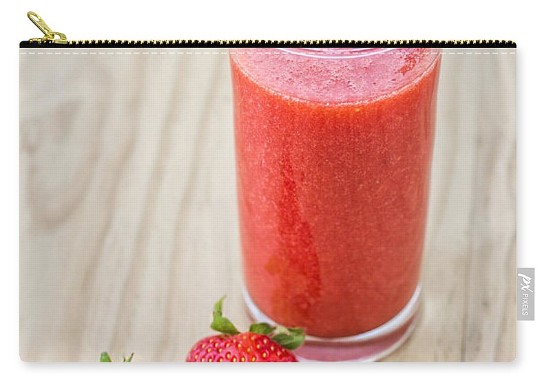 Berry Carry-all Pouch featuring the photograph Strawberry Juice by Paulo Goncalves