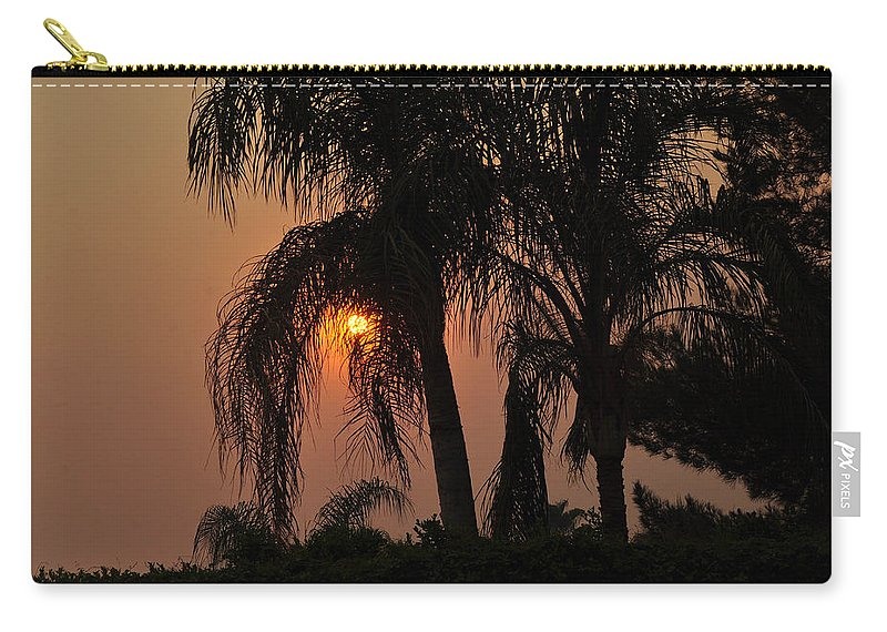 Fire Carry-all Pouch featuring the photograph Sun Setting Behind The Queen Palm Covered In Smoke by Jay Milo