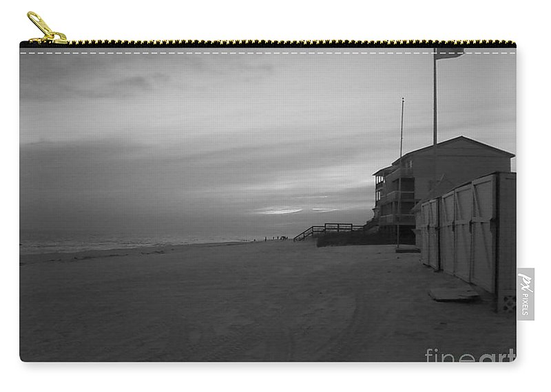 Black And White Carry-all Pouch featuring the photograph Sundown by Michelle Powell