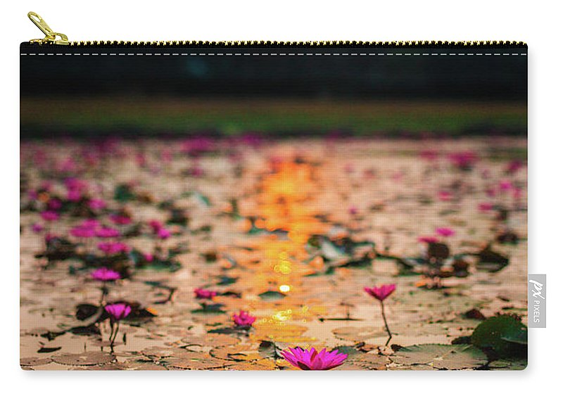 Tranquility Carry-all Pouch featuring the photograph Sunrise Over The Lotus Flowers Of by © Francois Marclay
