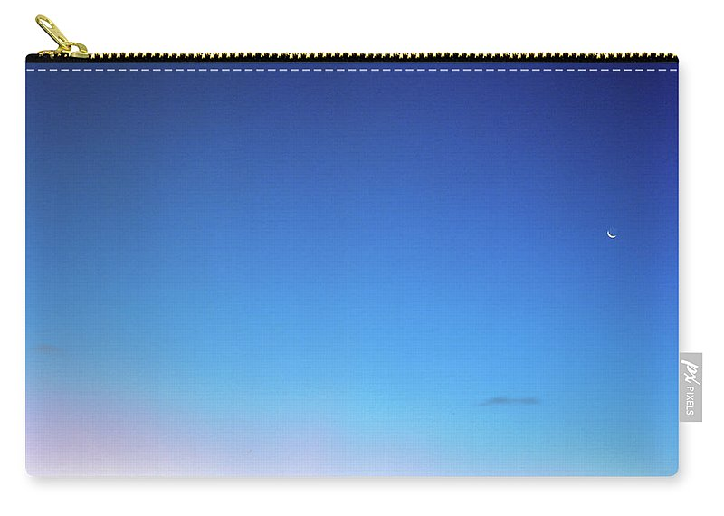 Tranquility Carry-all Pouch featuring the photograph Sunset And Moon At Uluwatu by Vsevolod Vlasenko