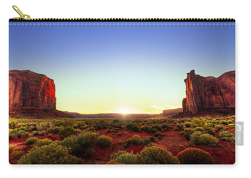 Rocks Carry-all Pouch featuring the photograph Sunset In Monument Valley by Alexey Stiop