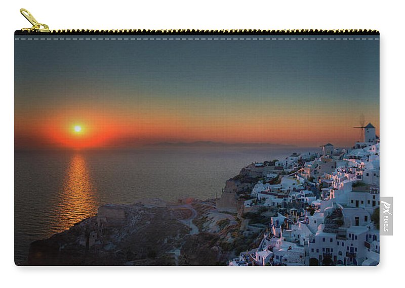 Tranquility Carry-all Pouch featuring the photograph Sunset In Santorini, Greece by Ed Freeman