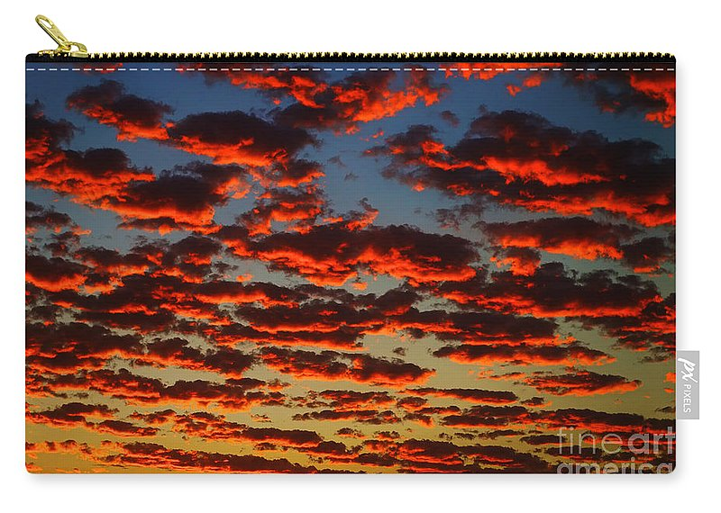 Sunset In The Clouds Carry-all Pouch featuring the photograph Sunset In The Clouds by Mariola Bitner