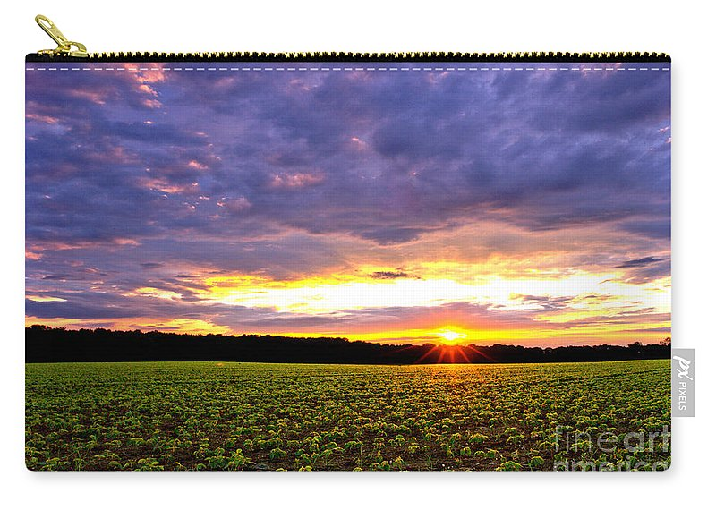 Sunset Carry-all Pouch featuring the photograph Sunset Over Farmland by Olivier Le Queinec