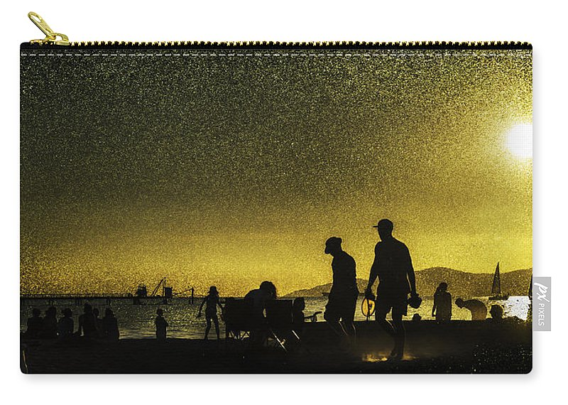 Back Lit Carry-all Pouch featuring the photograph Sunset Silhouette Of People At The Beach by Peter v Quenter
