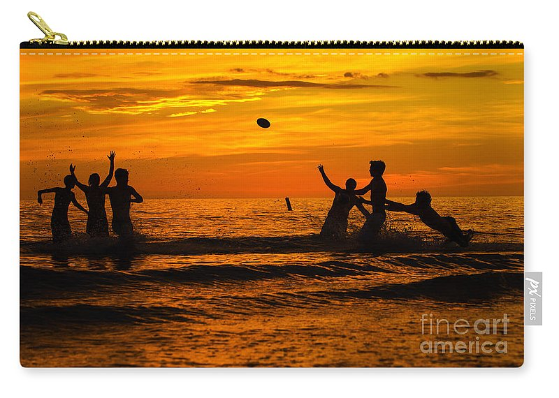 Sunset Carry-all Pouch featuring the photograph Sunset Water Football by Anne Kitzman