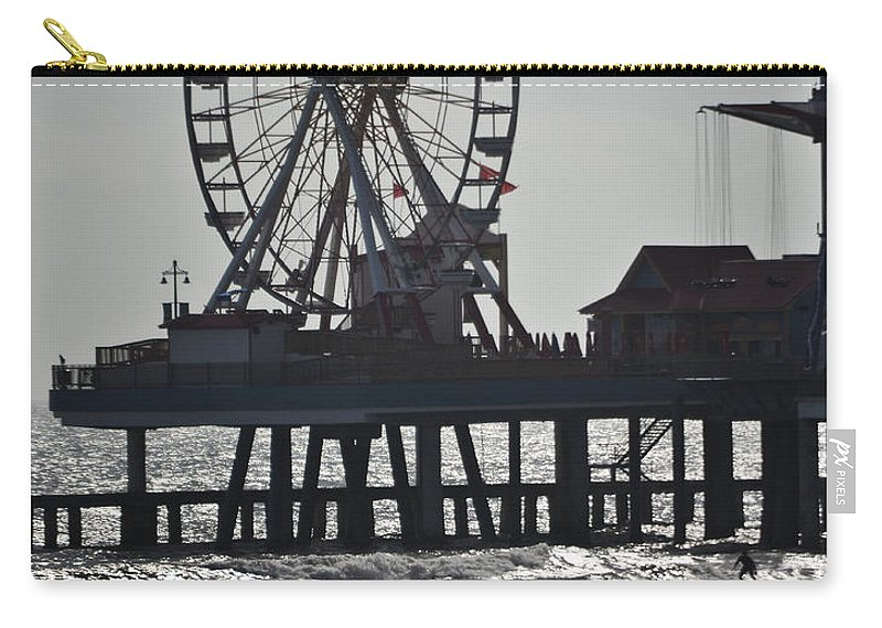 Galveston Carry-all Pouch featuring the photograph Surfer And Lovers At Pleasure Pier by Allen Sheffield