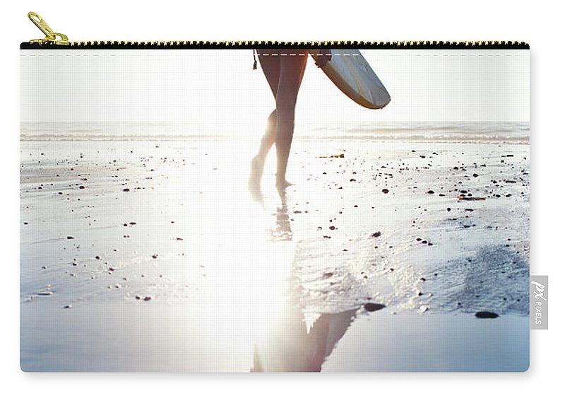 Youth Culture Carry-all Pouch featuring the photograph Surfer Girl by Ianmcdonnell