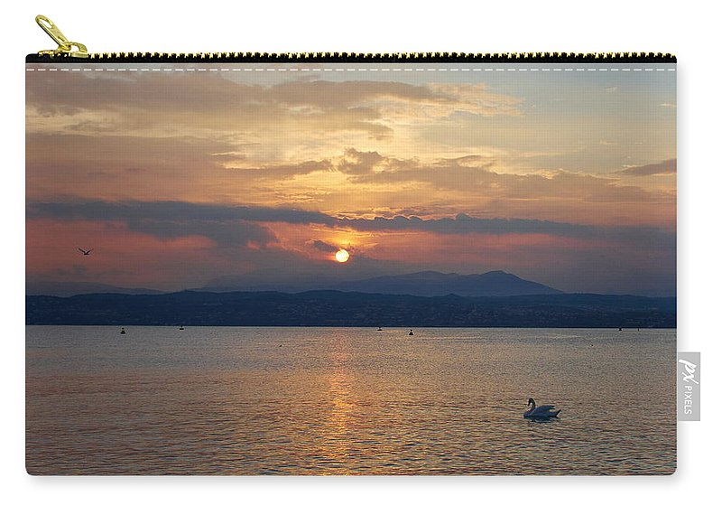 Francacorta Carry-all Pouch featuring the photograph Swan And Sunset. Sirmione. Lago Di Garda by Jouko Lehto