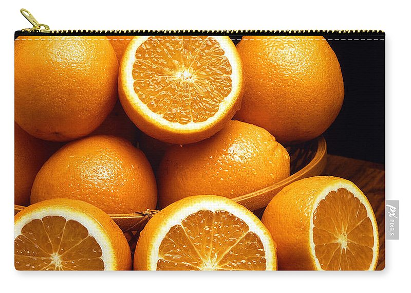 Orange Carry-all Pouch featuring the photograph Sweet Oranges Whole And Halved by Taiche Acrylic Art