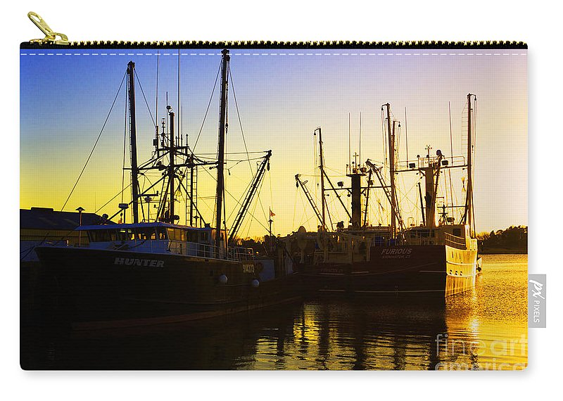 Commercial Carry-all Pouch featuring the photograph Tamed by Joe Geraci