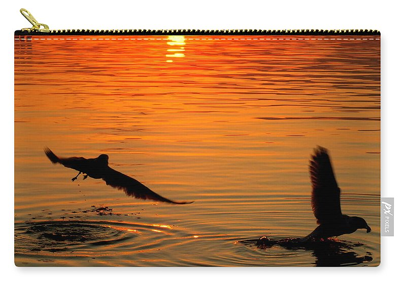 Seagulls Carry-all Pouch featuring the photograph Tangerine Moonlight by Karen Wiles