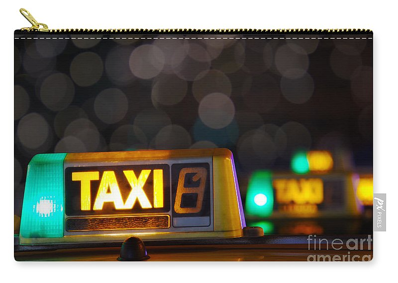 Auto Carry-all Pouch featuring the photograph Taxi Signs by Carlos Caetano
