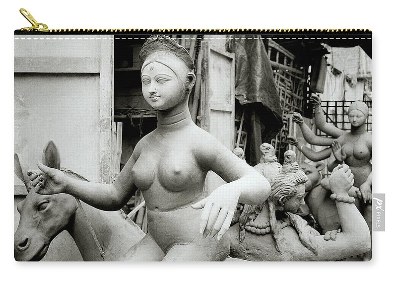 Art Carry-all Pouch featuring the photograph The Beautiful Idol by Shaun Higson