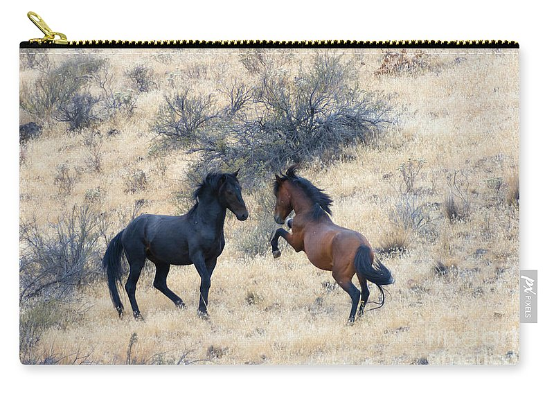 Challenge Carry-all Pouch featuring the photograph The Challenge by Mike Dawson