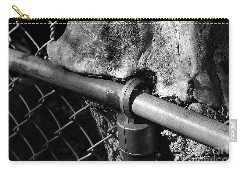 Fence Carry-all Pouch featuring the photograph The Fence Eating Tree by John Herzog