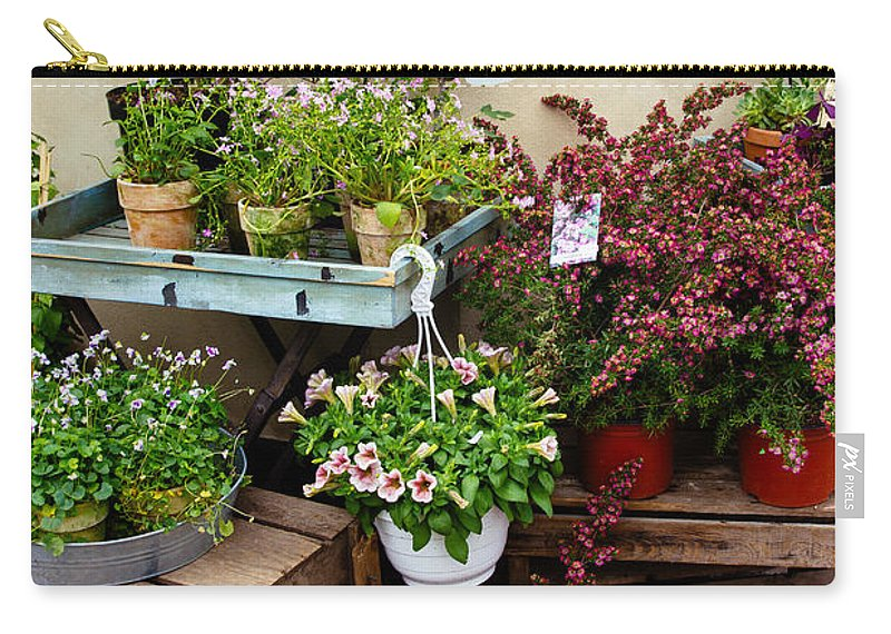 Store Carry-all Pouch featuring the photograph The Florist by Pati Photography