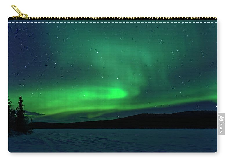Snow Carry-all Pouch featuring the photograph The Green Light Of The Aurora by Dave Moorhouse