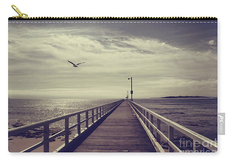 Pier Carry-all Pouch featuring the photograph The Jetty by Linda Lees