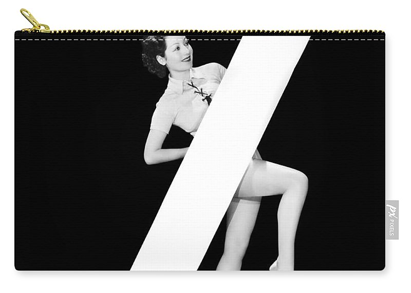 1035-579 Carry-all Pouch featuring the photograph The Letter z And A Woman by Underwood Archives
