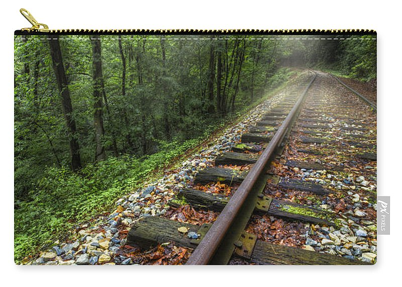 Andrews Carry-all Pouch featuring the photograph The Line by Debra and Dave Vanderlaan