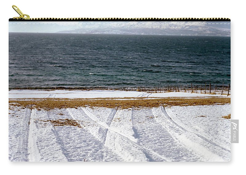 Coast Carry-all Pouch featuring the photograph The Lyngen Alps And Snowmobile Tracks by Kari Medig