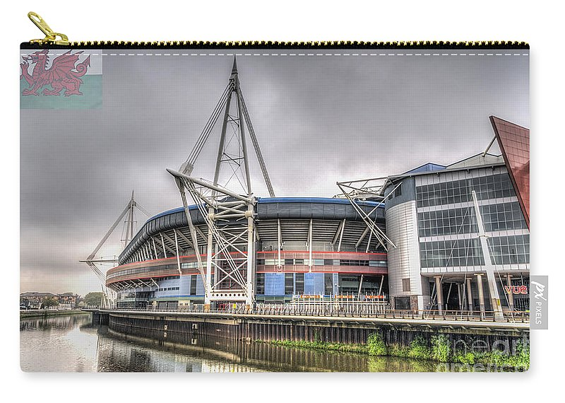 The Millennium Stadium Carry-all Pouch featuring the photograph The Millennium Stadium With Flag by Steve Purnell