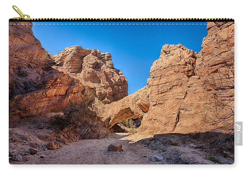 Anza-borrego Desert Carry-all Pouch featuring the photograph The Natureal Bridge by Peter Tellone