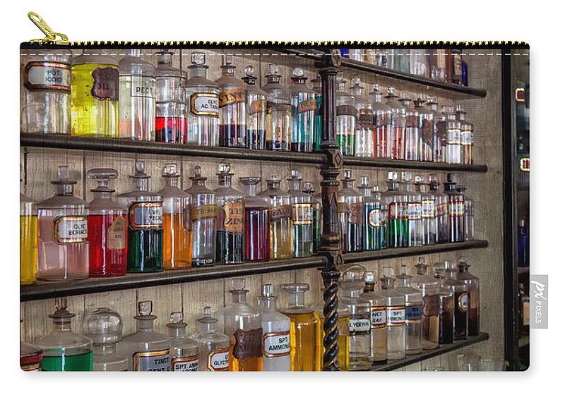 British Carry-all Pouch featuring the photograph The Pharmacy by Adrian Evans