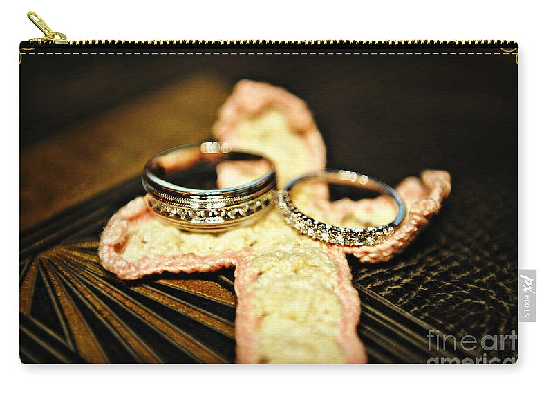 Cross. Rings Carry-all Pouch featuring the photograph The Rings by Eric Liller
