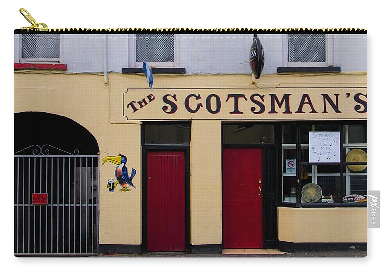Scottsmans Carry-all Pouch featuring the photograph The Scottsmans Bar - Donegal Ireland by Bill Cannon