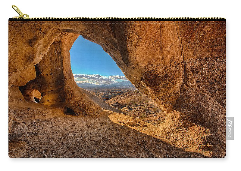 The Wind Caves Carry-all Pouch featuring the photograph The Wind Caves by Peter Tellone