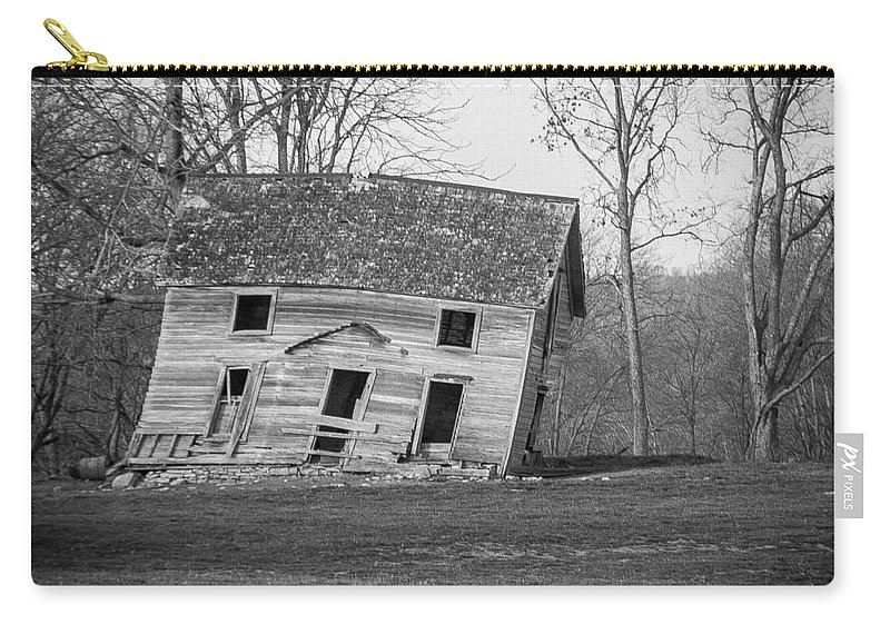 Black And White Carry-all Pouch featuring the photograph There Was A Crooked House by Ken Kobe
