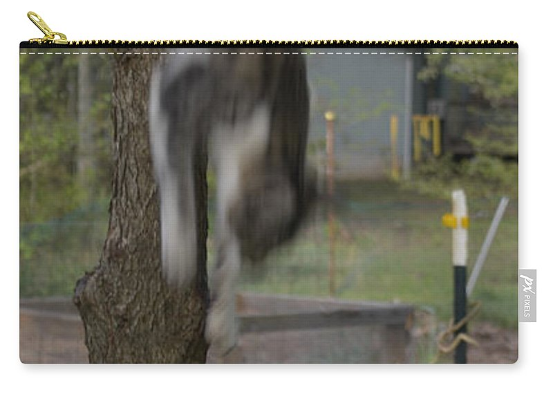 Animal Carry-all Pouch featuring the photograph They Call Him The Streak by Donna Brown