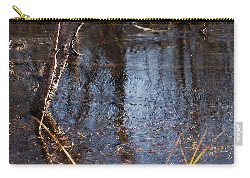 Ice Carry-all Pouch featuring the photograph Thin Ice Of A New Day by Susan Capuano