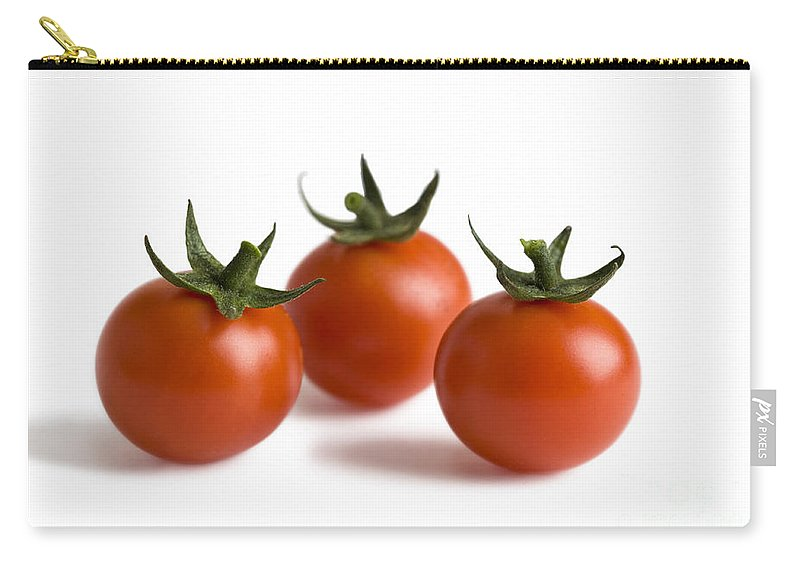 Tomatoes Carry-all Pouch featuring the photograph Three Cherry Tomatoes Isolated by Lee Avison