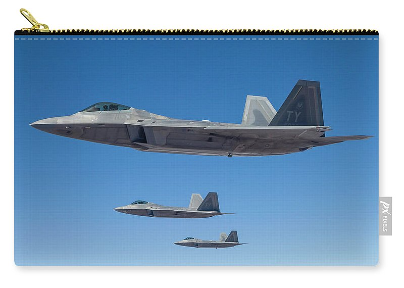 Formation Flying Carry-all Pouch featuring the photograph Three U.s. Air Force F-22 Raptors by Rob Edgcumbe/stocktrek Images