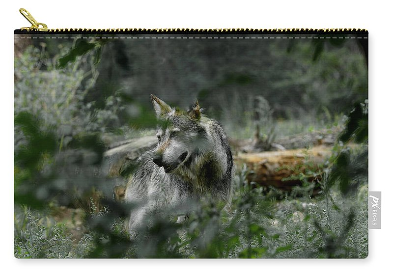 Wolf Carry-all Pouch featuring the photograph Through The Bushes by Ernie Echols