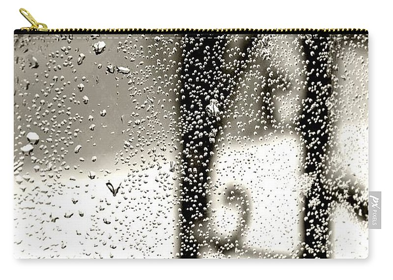 Rain Carry-all Pouch featuring the photograph Through The Raindrops by Bonnie Myszka
