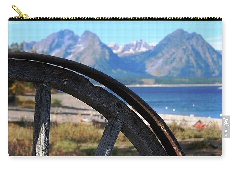 Landscape Carry-all Pouch featuring the photograph Through The Wheel by Deanna Cagle