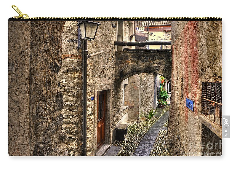 Alley Carry-all Pouch featuring the photograph Tight Alley With A Bridge by Mats Silvan