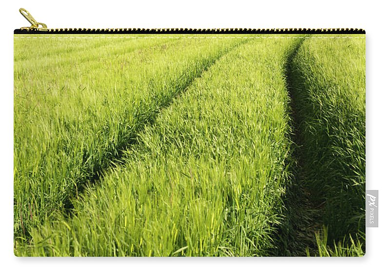Scenics Carry-all Pouch featuring the photograph Tire Tracks In Grain Field by Thomas Winz