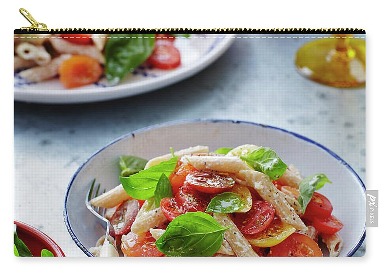 Serving Dish Carry-all Pouch featuring the photograph Tomato, Basil And Pasta Salad by Brett Stevens