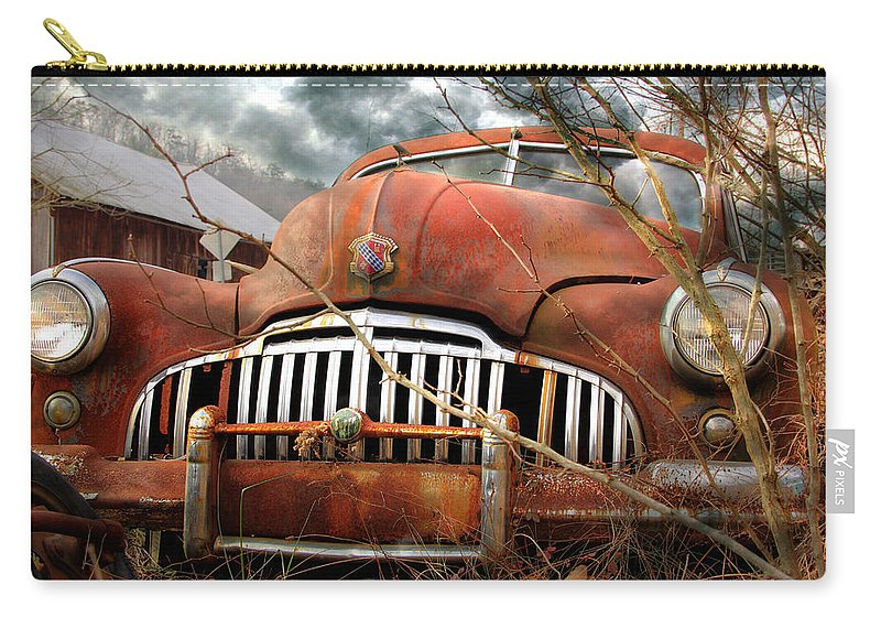 Rustic Carry-all Pouch featuring the photograph Toothless by Lori Deiter