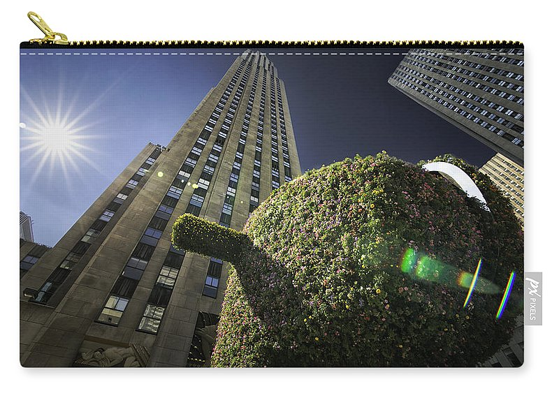 Facade Carry-all Pouch featuring the photograph Top Of The Rock by Fran Gallogly