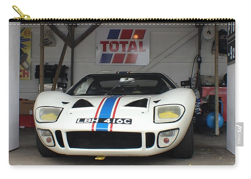 Total Carry-all Pouch featuring the photograph Total Ford Gt 40 by Robert Phelan