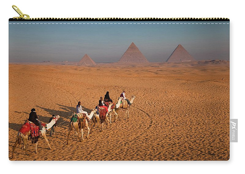 Working Animal Carry-all Pouch featuring the photograph Tourists On Camels & Pyramids Of Giza by Richard I'anson