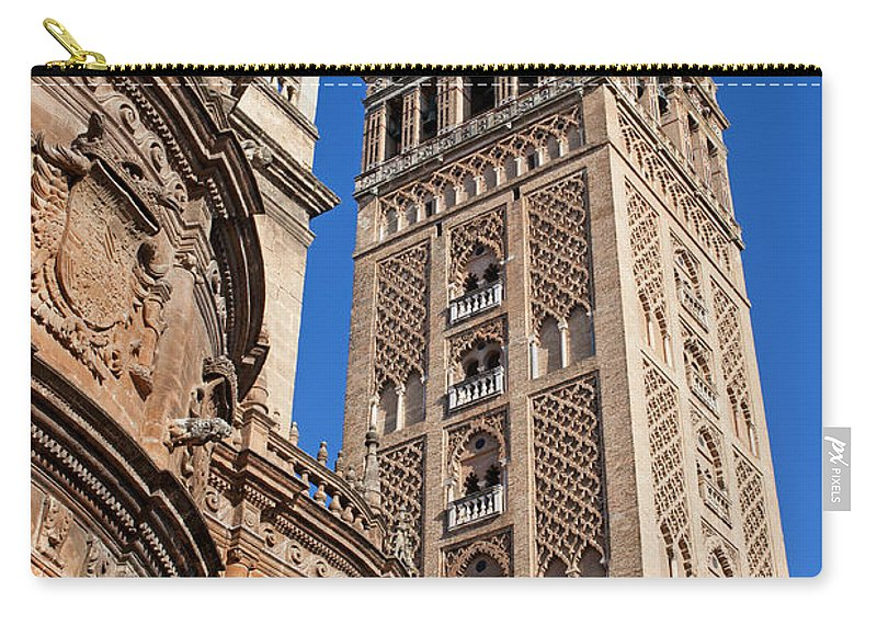 Almohad Carry-all Pouch featuring the photograph Tower Of The Seville Cathedral by Artur Bogacki